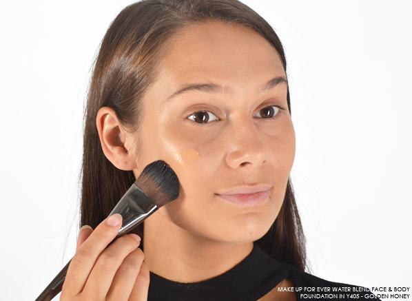 Applying the MAKE UP FOR EVER Water Blend Face and Body Foundation in Y405 - Golden Honey with the MAKE UP FOR EVER Foundation Brush - Large - 108